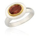 Oval faceted garnet ring by Lika Behar.